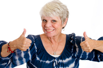 Happy mature woman with two thumbs up