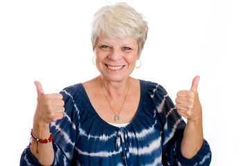 Happy Mature woman giving thumbs up.