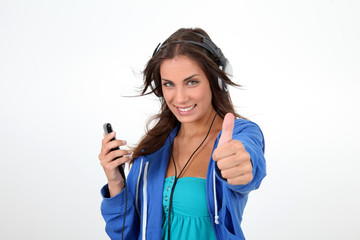 Portrait of teenager listening to music with headphones