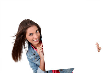 Smiling teenager showing whiteboard