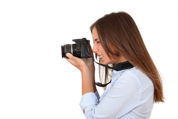 Portrait of woman using reflex digital camera