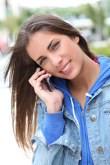 Portrait of young girl using smartphone