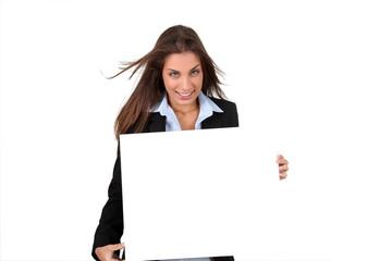 Smiling businesswoman holding whiteboard