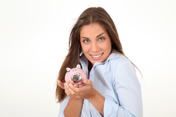 Portrait of beautiful woman holding piggybank