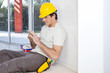 Construction worker with phone