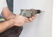 Human hand holding drill machine