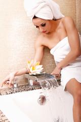 Woman getting ready for bath