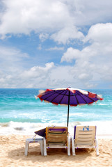 beach chair and white umbrella on beach