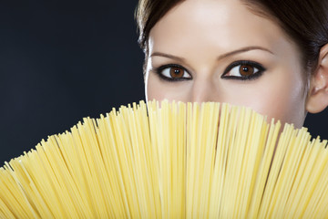 Detail of a beautiful woman with spaghetti