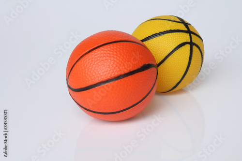 Two Basketball  orange and yellow.