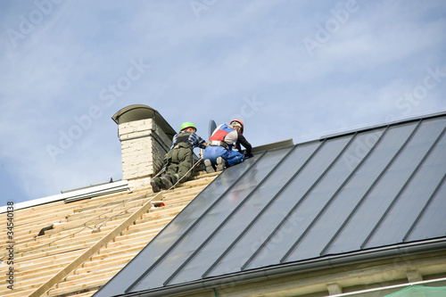 Work of roofers on a house roof poster