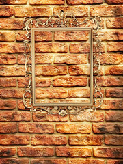 empty golden frame on brick wall