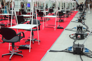 Rows of chairs, tables and mirrors for hairdresser