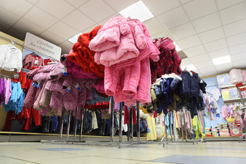 children clothing store, clothing on hangers and shelves