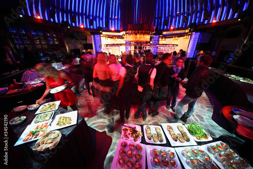 crowd of people relaxing in bar of night club