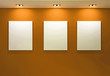 Gallery Interior with empty frames on orange wall