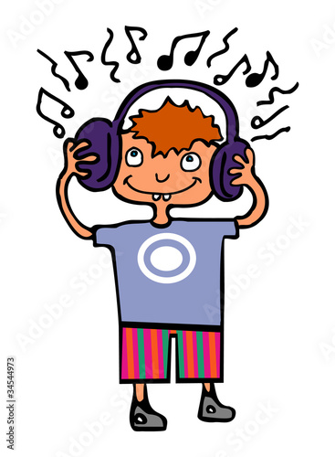 Funny boy listening to music on headphones