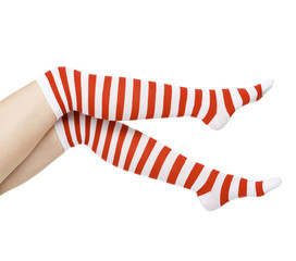 woman legs in color red socks, isolated on white