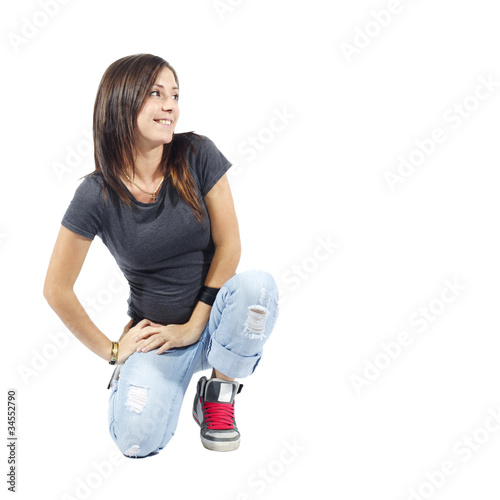 Woman kneeling down looking to her left