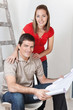 Couple with Home Blueprints