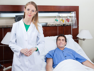 Confident female doctor with patient
