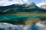 Emerald lake in perfect symmetry poster