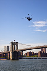 NYPD helicopter over the Brooklyn Bridge