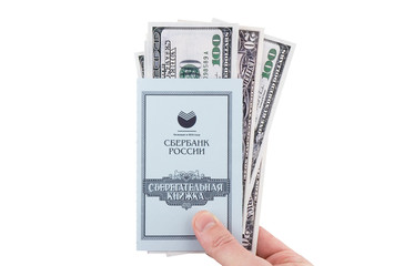 Russian Savings book with dollars,holding in hand.