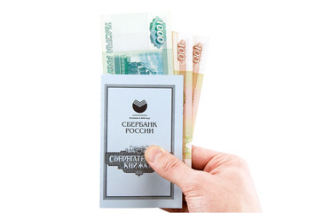 Russian Savings book with rubles, holding in hand.