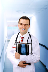Friendly medical doctor with a x-ray image.