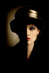Woman fashion portrait in black hat