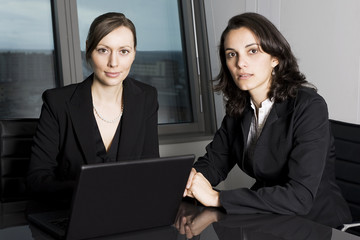 Latin businesswomen in office