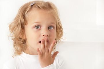 Scared amazed little girl  on white background