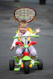Little baby girl on bike