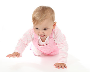 Cute baby girl crawling on white
