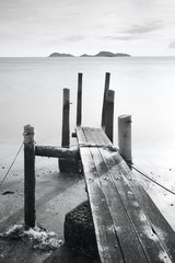 pier go into sea , black and white