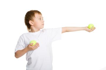 Boy holds tennis balls.