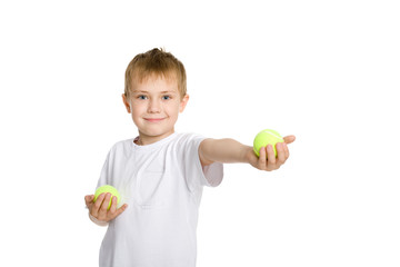 Boy playing in the tennis balls.