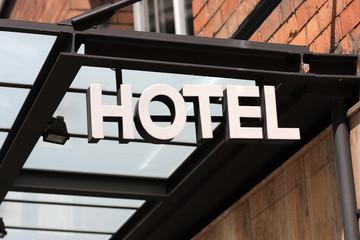 metallic hotel sign