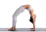 young woman in yoga asana - bridge pose isolated