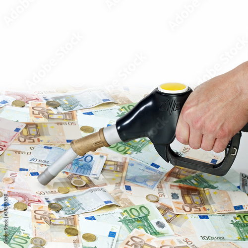 Fuel nozzle and money on white background