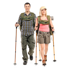 Man and woman with backpacks and hiking poles