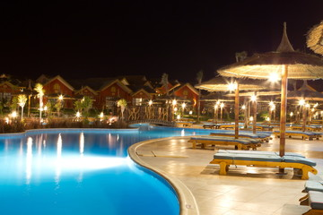Hotel swimming pool at night