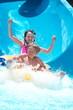 Kids playing on water slide