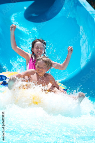 Kids playing on water slide