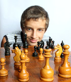 smiling young boy across the chessboard