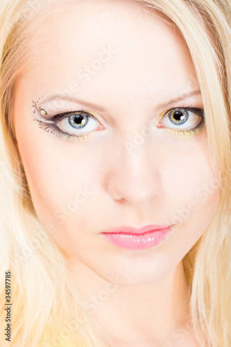 Young beautiful blonde woman with make-up
