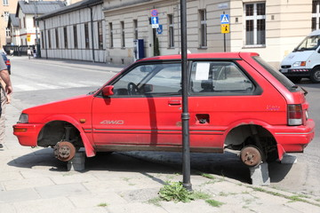 Red Car, parked with no wheels