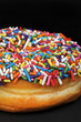 Sprinkled Rainbow Doughnuts.
