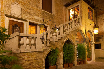 Entrance of a charming Italian building at night